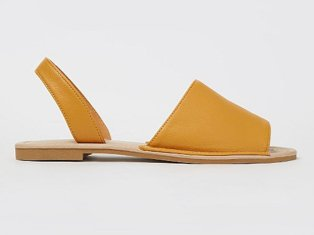 Ochre faux leather slip on sandals.