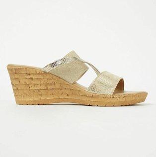 Gold cork effect wedge heel sandals.