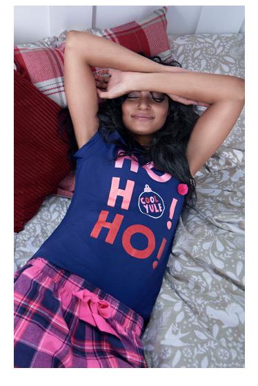A model wears women's festive pyjamas